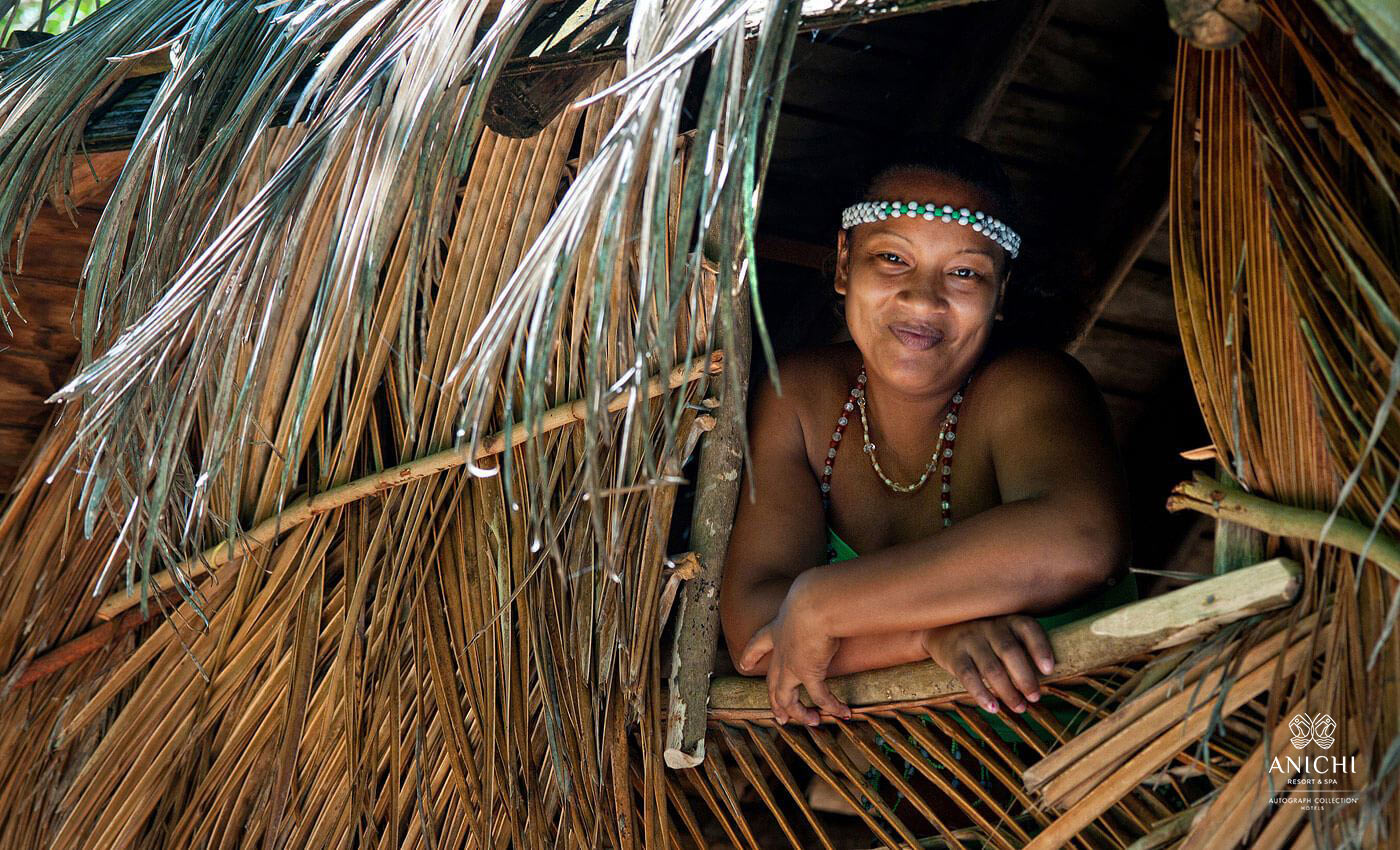 Kalinago - a native Carib woman in traditional house