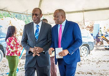 Dr. Michael Lawerence, a Director at Oriental Developers (Caribbean) Ltd. and Hon. Roosevelt Skerrit, PM of Dominica exchange a quite joke will entering the groundbreaking ceremony